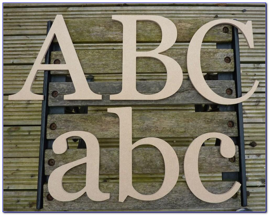 8 White Wooden Letters