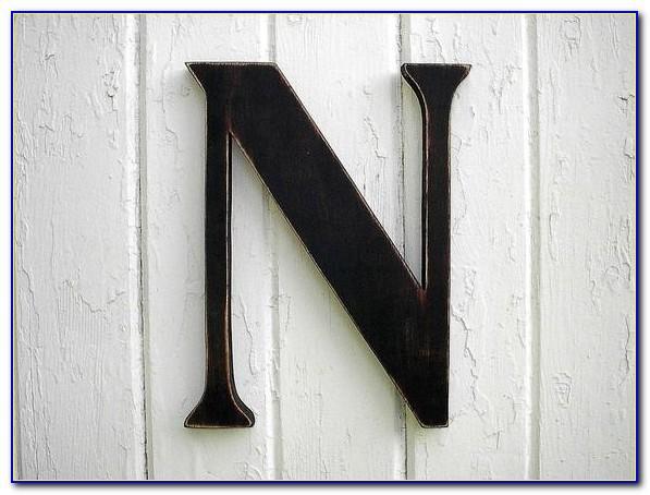 Black Wooden Letters Next